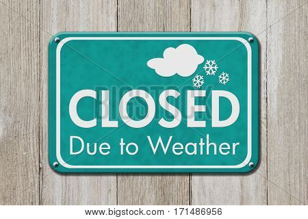 Closed due to weather sign A teal sign with text Closed due to weather on weathered wood 3D Illustration