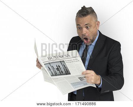 Caucasian Business Man Reading Newspaper Shocked