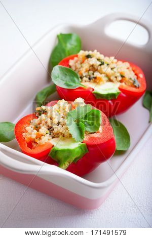 Stuffed red peppers filled with quinoa and vegetables