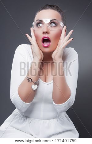 Sexy Caucasian Brunette Woman With Both Hands Lifted Showing Poisitive Facial Expression While Exclaiming. Vertical Image Orientation