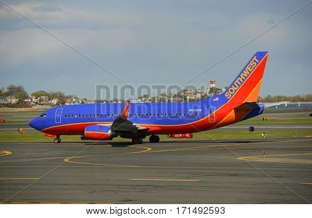 BOSTON - MAY. 6, 2014: Southwest Airlines Boeing 737-300 taxiing at Boston Logan International Airport, Boston, Massachusetts, USA.