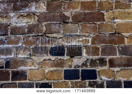 Close-up view of old building with dark brick wall background concept