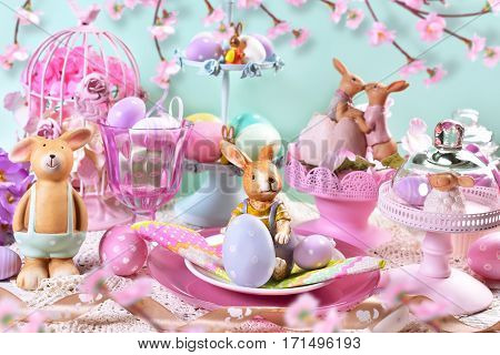 beautiful easter table decoration with painted eggs rabbits and flowers in pastel colors