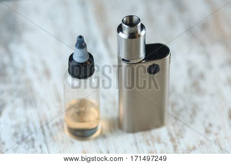 Jar With Fluid For Personal Vaporisers And E-cigarette. Electronic Nicotine Delivery Systems. Ends.
