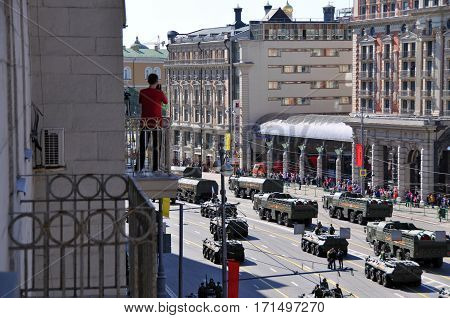 MOSCOW/ RUSSIA - MAY 9, 2014: Resident of the house on Tverskaya street is watching the parade on victory day in Moscow, Russia.