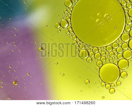 Oil in water forming green circles abstract background