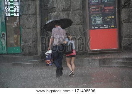 Kiev Ukraine - May 27 2016: Ctizens are under the umbrella in a thunderstorm on Khreschatyk Street