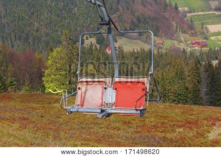 Red chair ski lift on a background of the spring landscape