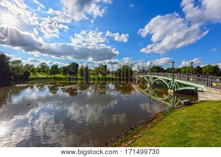 View of the Western arched bridge over the pond in the Park Tsaritsino. Moscow, Russia.