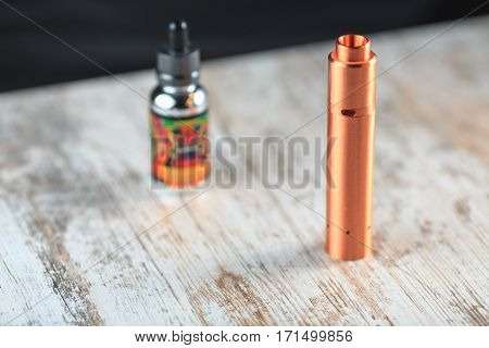 Electronic Cigarette And A Bottle With Fluid. Mechanical Mod.