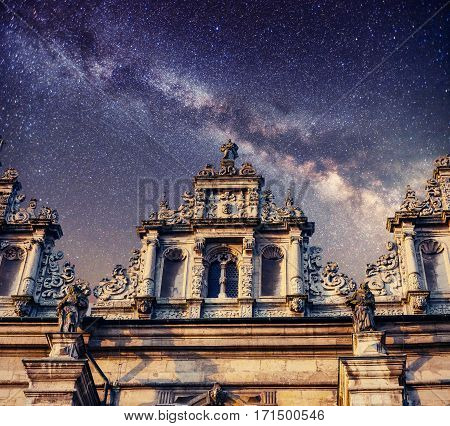 Architecture outside church. Night time starry sky. Retro stale