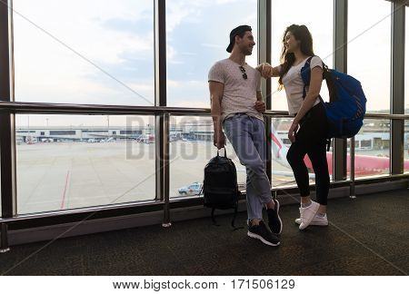Young Couple In Airport Lounge Waiting Departure Happy Smile Man And Woman Flight Holiday Vacation Travel
