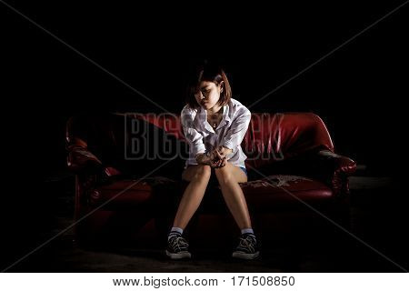 Unhappy Lonely Depressed Woman Sitting On Old Couch And Contemplating Suicide, In Scary Abandoned Bu