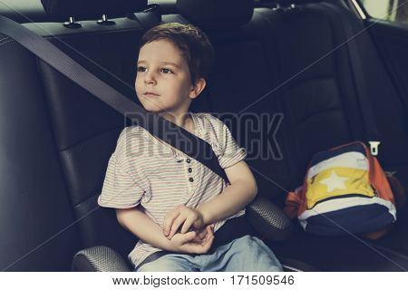 Boy into the Car Using Seatbelt Protect Security