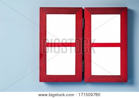 The empty red wooden photo frame on gray wall. Save clipping path.