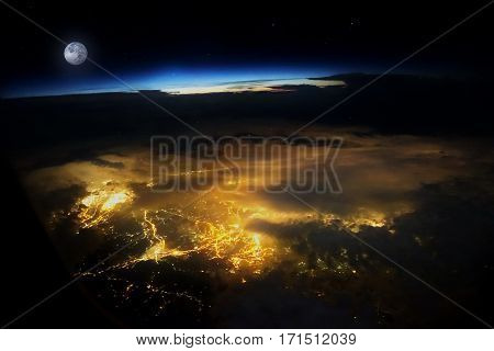 The Sky, Stars, Moon, And City Light Between Flight .