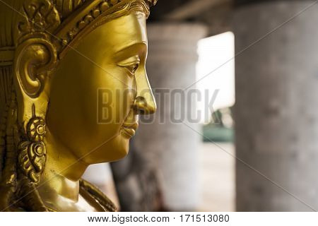 the face of the golden Buddha statue in Thailand.