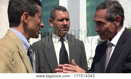 Executive Talking To Employees and Wearing Business Suits