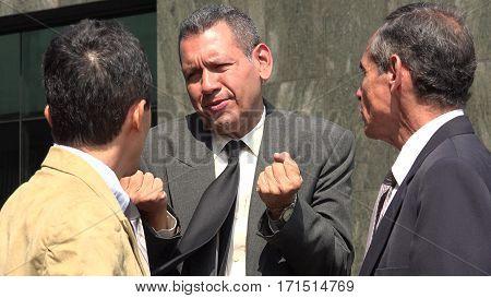 A Team of Business Men Have a Disagreement