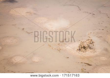 Mud pool in the Wai-o-tapu geothermal area, Rotorua, New Zealand