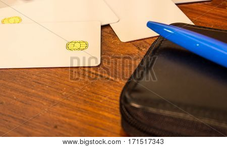new blank of chip cards on wooden table