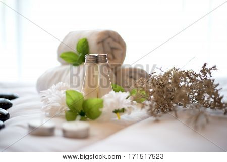 Spa treatment and product and relax spa with the bed and white flowers Thailand. Greenery tone 2017 select focus