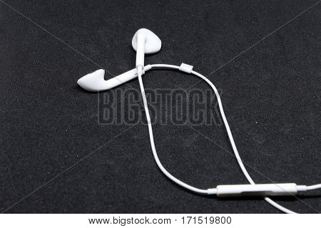Earphone on the black background .white Earphone .