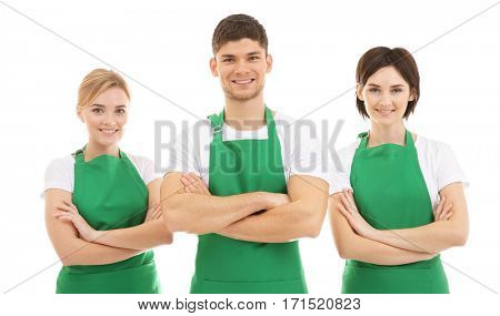 Cleaning staff in green aprons on white background
