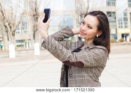 Casual Cheerful Girl Alone with mobile phone Outdoor Recreation Concept