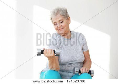 Elderly patient training in rehabilitation center poster