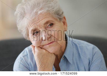 Depressed elderly woman at home