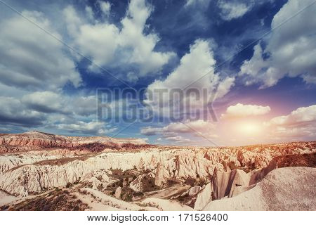 Fantastic sunrise over the Red Valley in Cappadocia, Anatolia, Turkey. Volcanic mountains in Goreme National Park.