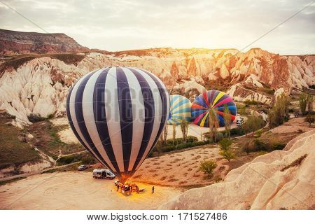 Cappadocia, Turkey. The first crew of flame and heat for inflating the balloon before launch. Balloon is one of the most famous of that trip will have to do in Cappadocia