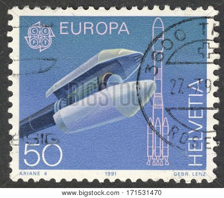 MOSCOW RUSSIA - CIRCA JANUARY 2017: a post stamp printed in SWITZERLAND shows cargo load cladding of the carrier rocket