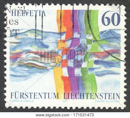 MOSCOW RUSSIA - CIRCA JANUARY 2017: a post stamp printed in SWITZERLAND shows coloured lines crossing a river dedicated to the Treaty Switzerland-Liechtenstein circa 1995