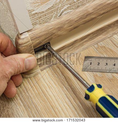 Builder Assembles Plinth At Corner Of Room
