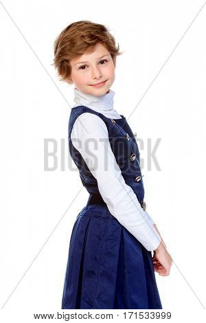 Happy school girl in school uniform. Isolated over white background. Education. Copy space.