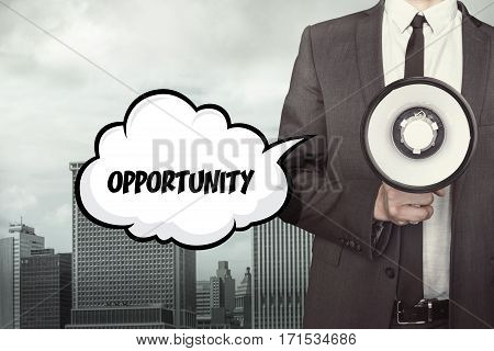Opportunity text on speech bubble with businessman holding megaphone