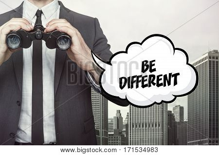 Be different text on  blackboard with businessman and key