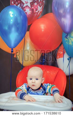 Baby In The Highchair With Balloons
