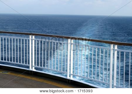 View From A Cruise Ship Deck Looking Out Onto The Water