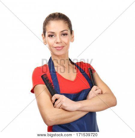 Beautiful female hairdresser on white background