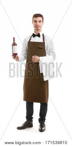 Cute waiter holding bottle of wine over white background