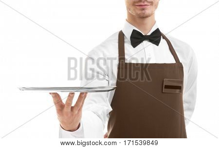 Waiter holding empty silver tray over white background.Focus on the tray