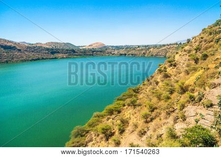 A lake in Africa Etophia. Dired earth and green water.