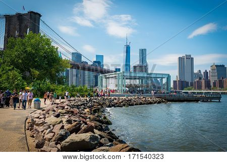 Crowd enjoying the beautiful day in the Brooklyn Bridge park on Aug 11th, 2013.