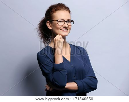 Young woman with spectacles on grey background