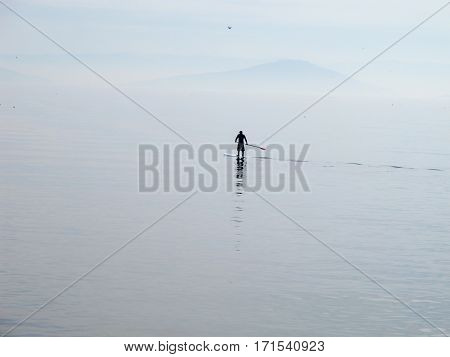 Lonely paddleboarder on the Marmara sea rowing to nowhere