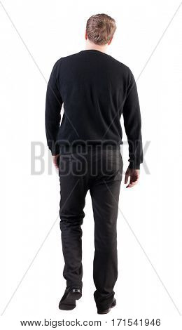 back view of walking  business man.  Isolated over white background. Rear view people collection.  backside view of person.  stylish man in black sweater and pants went off