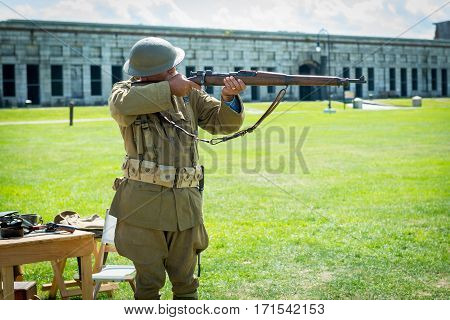 Veteran demostrating vintage assult rifle from WWII in Fort Adams of Rhode Island on September 2013.